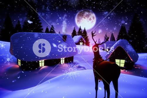 Snow covered village under full moon