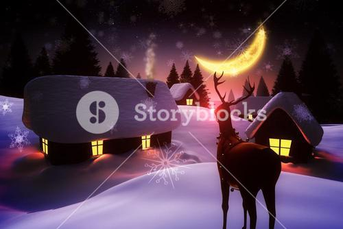 Snow covered village and rudolph