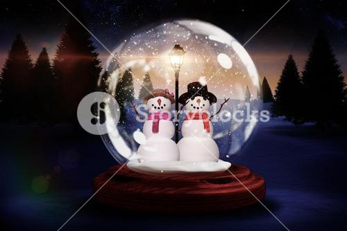 Snowman and woman in a snow globe