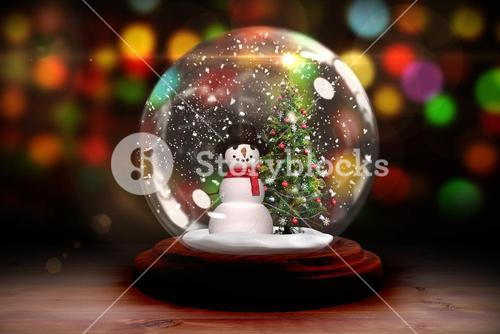 Christmas tree and snowman in snow globe