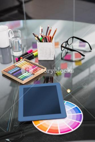 Colour samples and digitizer on desk