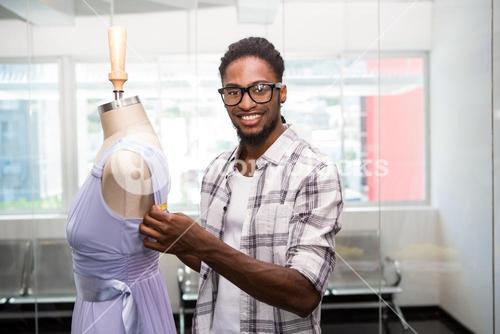 Male fashion designer and mannequin