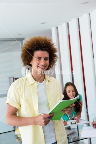 Portrait of smiling casual man with file