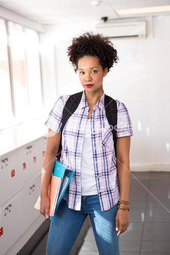 Casual young woman with folder