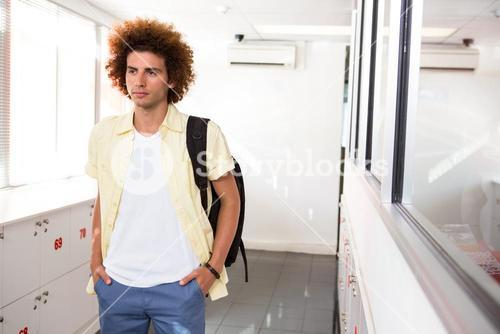 Casual young man in office corridor