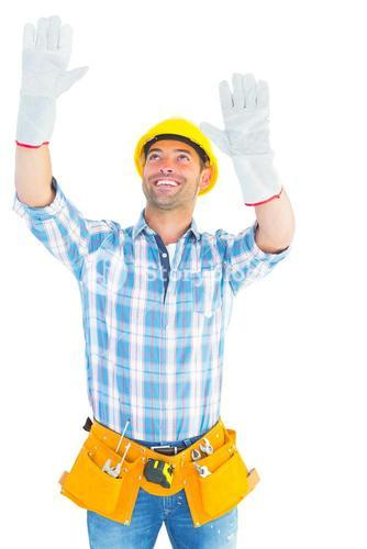 Manual worker raising hands while looking up