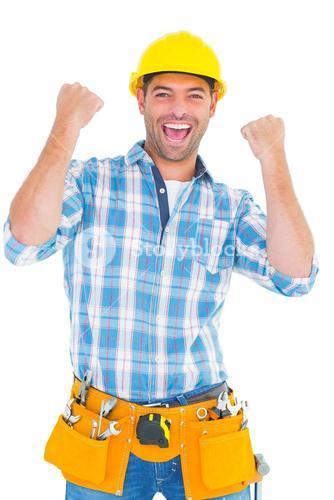 Excited manual worker clenching fists