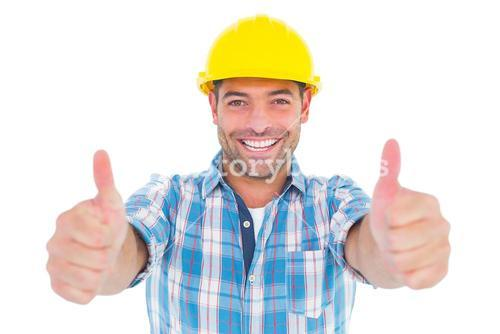 Smiling manual worker gesturing thumbs up