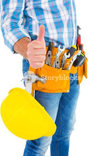 Midsection of manual worker gesturing thumbs up