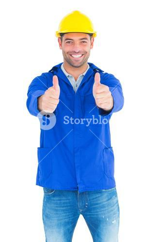 Portrait of happy manual worker gesturing thumbs up