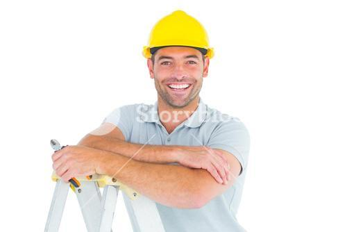 Happy repairman with pliers on ladder
