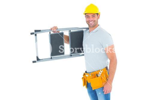Happy manual worker carrying step ladder