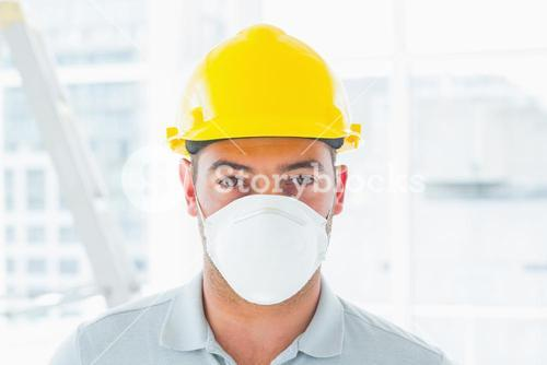 Handyman wearing protective workwear at site