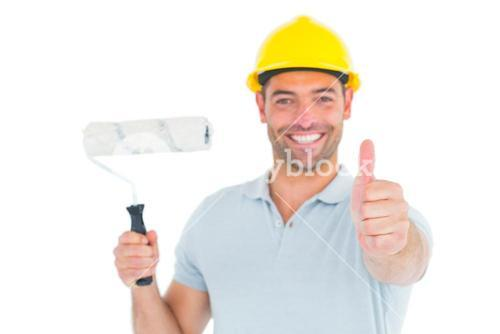 Manual worker with paint roller gesturing thumbs up