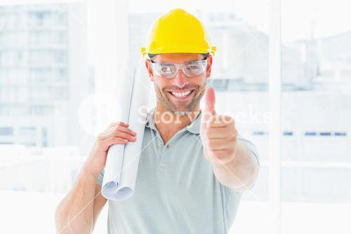 Happy handyman with rolled up blueprint gesturing thumbs up