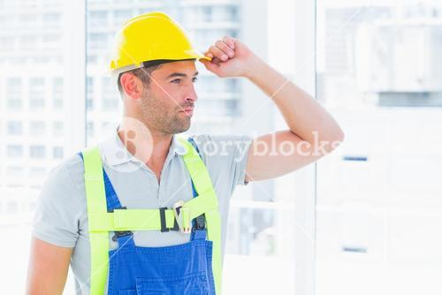 Manual worker wearing yellow hard hat