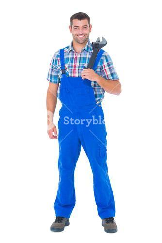 Confident male repairman holding adjustable wrench