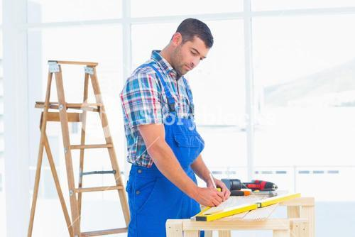 Handyman working at workbench in office