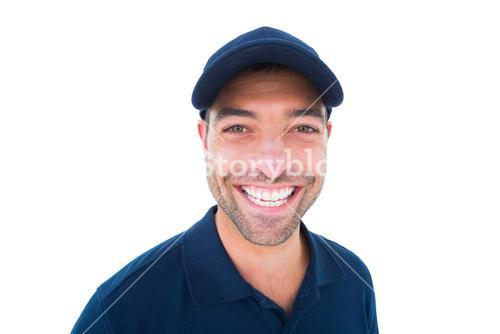 Portrait of cheerful delivery man wearing cap