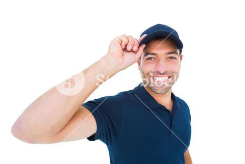 Smiling delivery man wearing cap on white background