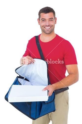 Delivery man removing pizza box from bag