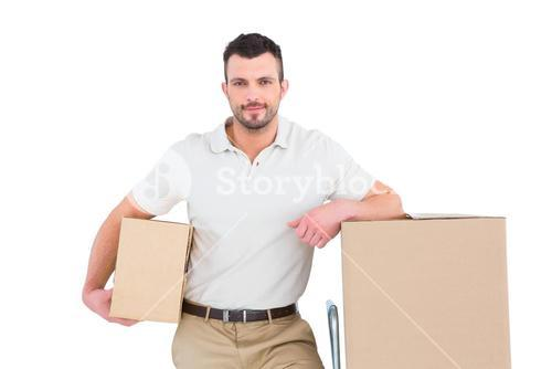 Delivery man with trolley of boxes