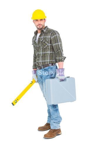 Manual worker with spirit level and toolbox