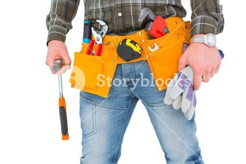 Manual worker holding gloves and hammer