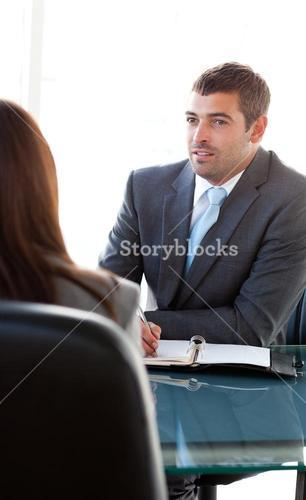 Rear view of a businesswoman talking with a charismatic businessman