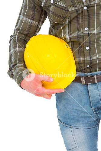Manual worker holding helmet