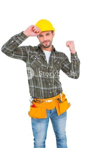 Smiling manual worker clenching fist