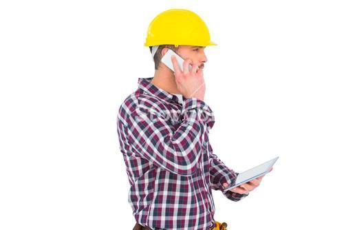 Repairman on the phone holding tablet pc