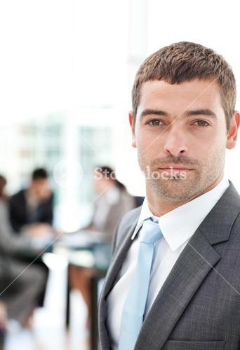 Charismatic businessman standing in the foreground