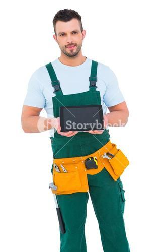 Construction worker holding tablet pc
