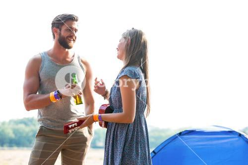 Two friends chatting in campsite