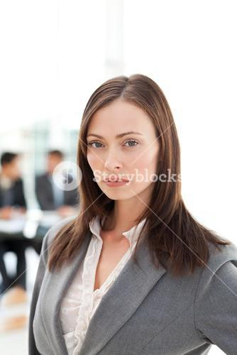 Serious businesswoman during a meeting with two businessmen