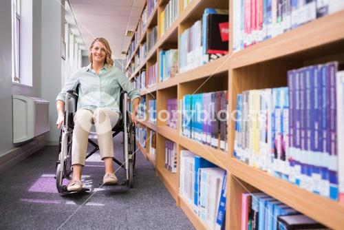 Smiling disabled student in library