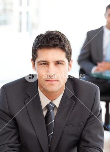 Serious businessman during an interview with a coworker