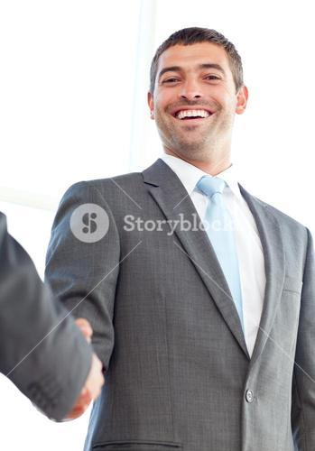 Below view of a happy businessman concluding a deal with a partner