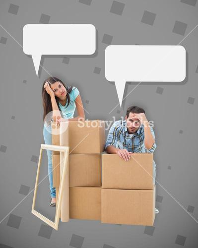 Composite image of stressed young couple with moving boxes