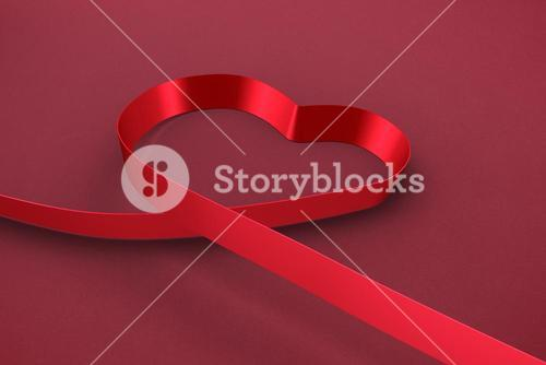 Composite image of red ribbon heart