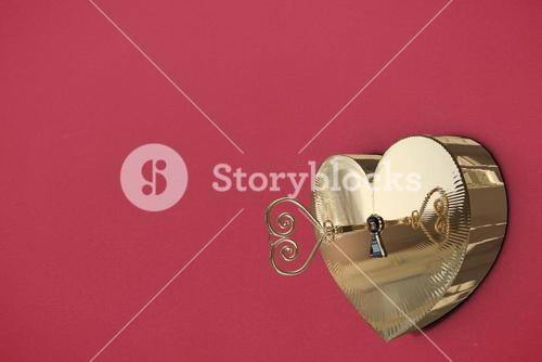 Golden heart lock with key