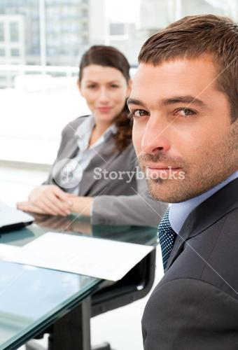 Charismatic businessman during a meeting with his colleague