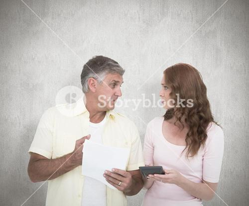 Composite image of casual couples working out their bills