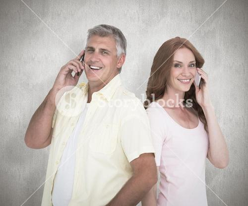 Composite image of casual couple on their phones