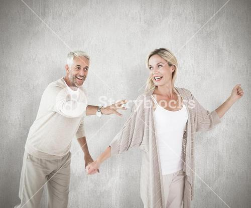 Composite image of happy couple messing about together