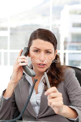 Dissatisfied businesswoman talking on the phone