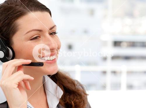 Smiling businesswoman talking on the phone with headphones