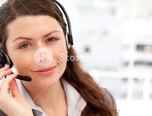 Pretty businesswoman with earpiece smiling at the camera