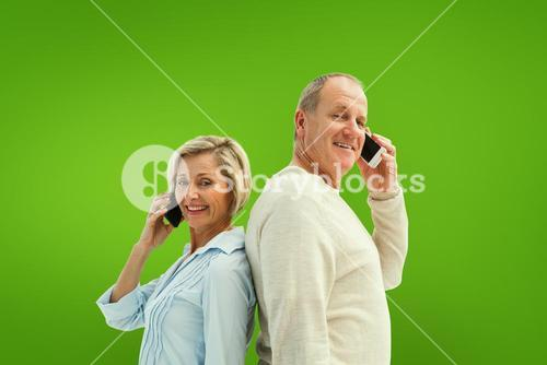 Composite image of happy mature couple talking on their phones
